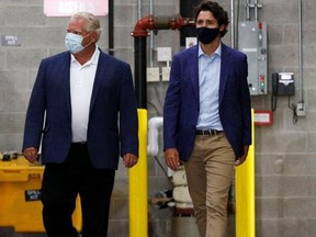 Premier Doug Ford (left) and Prime Minister Justin Trudeau are pictured on Aug. 21, 2020 when they announced a 3M plant in Brockville would be making N95 masks.