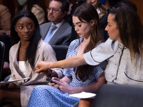 US Olympic gymnasts Simone Biles, left, McKayla Maroney, centre, and Aly Raisman, right, arrive to testify during a U.S. Senate Judiciary hearing about the Inspector General's report on the FBI handling of the Larry Nassar investigation of sexual abuse of Olympic gymnasts, on Capitol Hill, in Washington, D.C., Wednesday, Sept. 15, 2021.