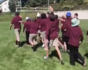 """Screengrab of a video that has been circulating around social media showing students from Algonquin, on school property, chanting """"f*** Jews"""" and """"Heil Hitler,"""" while holding their arms in a Nazi salute."""