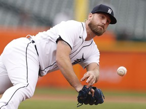 Detroit Tigers relief pitcher Ian Krol makes a diving throw to first base but commits a throwing error on a ball hit by Chicago White Sox designated hitter Yoan Moncada (not pictured) during the sixth inning at Comerica Park. Moncada reaches second base.