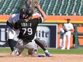 Detrot Tigers shortstop Niko Goodrum tags Chicago White Sox baserunner Jose Abreu while stealing second base and causes a ninth-inning bench clearing brawl at Comerica Park. Mandatory Credit: Dale Young-USA TODAY Sports