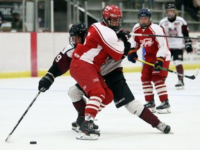 Leamington Flyers' Colton O'Brien (5) hits Chatham Maroons' David Brown (89) during an exhibition game in Chatham on Sunday. The Maroons won 5-4.