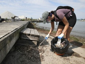 Hannah Schaefer participates in the Detroit River cleanup event at the McKee Park in Windsor on Saturday, Sept. 11, 2021.