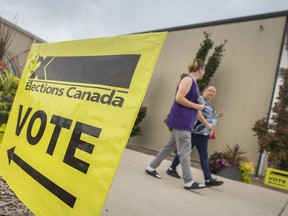 People exit the WFCU Centre after voting in the riding of Windsor-Tecumseh on Election Day, on Monday, Sept. 20, 2021.