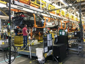 FILE PHOTO: Workers assemble Chevy Bolt EV cars at the General Motors assembly plant in Orion Township, Michigan, U.S. November 4, 2016.