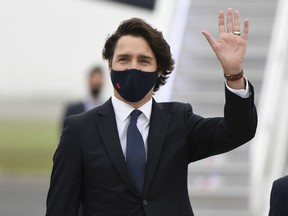Prime Minister Justin Trudeau waves as he arrives ahead of the G7 meeting at Cornwall airport on June 10, 2021 in Newquay, England.