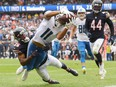 Detroit Lions wide receiver Kalif Raymond scores a touchdown in the second half against Chicago Bears defensive back Deon Bush at Soldier Field.