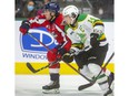 Windsor Spitfires' captains Will Cuylle, left, battles with London Knights' captain Luke Evangelista during Friday's game at Budweiser Gardens.