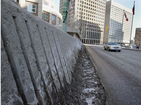 The city is considering removing the barricades at Portage and Main to allow pedestrians to cross at street level.