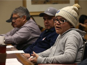 Melodie Harper (right) speaks during a press conference at the Manitoba Legislative Building in Winnipeg on Monday, to address health care concerns. Her husband Vernon is at centre, with St. Theresa Point First Nation chief David McDougall at far left.