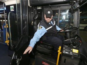 Bus Operator, Logan Poole, sits in the driver's seat of a transit bus, at the unveiling event for a shield intended to improve the safety of bus drivers. Friday, November 24, 2017.   Sun/Postmedia Network Chris Procaylo, Chris Procaylo/Winnipeg Sun