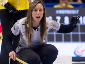 Skip Rachel Homan, of Ottawa, watches a shot approach the house during the Olympic curling trials on Dec. 4, 2017