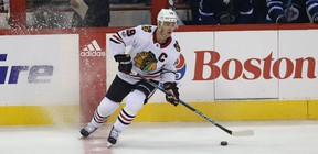Chicago Blackhawks centre Jonathan Toews puts on the brakes at the centre ice during NHL action against the Winnipeg Jets. (Kevin King/Winnipeg Sun)