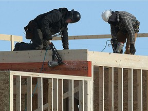 Tradespeople work on new housing construction on Templeton Avenue in north Winnipeg on Thu., Feb. 9, 2017. Kevin King/Winnipeg Sun/Postmedia Network ORG XMIT: POS1702091621192027