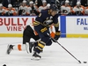 Buffalo Sabres forward Evander Kane (9) skates the puck into the zone during the first period of an NHL hockey game against the Philadelphia Flyers, Friday, Dec. 22, 2017, in Buffalo, N.Y. (AP Photo/Jeffrey T. Barnes) ORG XMIT: NYJB104
