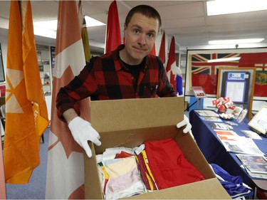 Shayne Campbell, who is the president and executive director of Settlers, Rails & Trails, opens one of seven boxes of flags from the Ralph Spence collection which arrived at the local museum in Argyle, Man., located 50 kilometres northwest of Winnipeg, Man. on Friday, March 2, 2018. (Brook Jones/Stonewall Argus & Teulon Times/Postmedia Network)