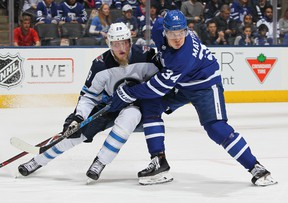 TORONTO, ON - MARCH 31:  Patrik Laine #29 of the Winnipeg Jets skates against Auston Matthews #34 of the Toronto Maple Leafs during an NHL game at the Air Canada Centre on March 31, 2018 in Toronto, Ontario, Canada. (Photo by Claus Andersen/Getty Images)