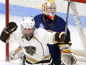 Courtlyn Oswald of the Manitoba Bisons celebrates her first period goal in front of Queens Gaels goaltender Stephanie Pascal in their USports women's hockey quarterfinal game Friday March 16, 2018.  Mike Hensen/The London Free Press/Postmedia Network