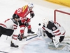 Switzerland's Lino Martschini, center, in action against Canada's Zach Whitecloud, left, and Canada's goaltender Ben Scrivens during the 2017 Karjala Cup ice hockey match between Switzerland and Canada in the Tissot Arena in Biel, Switzerland, on Wednesday, Nov. 8, 2017. (Peter Schneider/Keystone via AP) ORG XMIT: LON841
