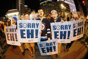 Winnipeg Jet fans celebrate at Portage an Main in downtown Winnipeg after the Winnipeg Jets defeated the Minnesota Wild in Game 5 Friday to win the first round 4-1.