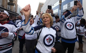 Fans cheer at the Winnipeg Whiteout Street Party on Donald Street on Wed., April 11, 2018. Kevin King/Winnipeg Sun/Postmedia Network