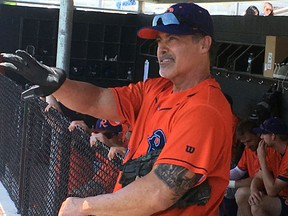 Cleburne Railroaders newly signed player and former Major League player, Rafael Palmeiro, talks with reporters from the dugout after a spring training baseball game in Cleburne, Texas, on May 10, 2018