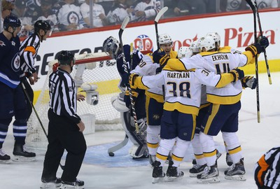 Winnipeg Jets goaltender Connor Hellebuyck fishes the puck out of the net after Nashville Predators centre Mike Fisher scored during Game 2 of their second-round playoff series in Winnipeg on Tues., May 1, 2018. Kevin King/Winnipeg Sun/Postmedia Network