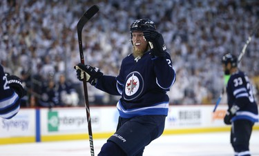 Winnipeg Jets forward Patrik Laine celebrates his goal late in the third period against the Nashville Predators during Game 4 of their second-round NHL playoff series in Winnipeg on Thurs., May 3, 2018. Kevin King/Winnipeg Sun/Postmedia Network