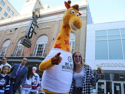 Rebecca Martin and a very tall friend meet at the Whiteout Street Party before the Winnipeg Jets faced the Vegas Golden Knights in Game 2 of the Western Conference final in Winnipeg on Mon., May 14, 2018. Kevin King/Winnipeg Sun/Postmedia Network