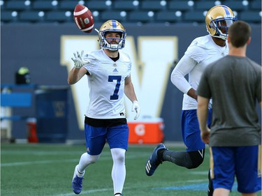 Weston Dressler flips the ball on his way back to the huddle during Winnipeg Blue Bombers training camp at Investors Group Field in Winnipeg on Mon., May 28, 2018. Kevin King/Winnipeg Sun/Postmedia Network