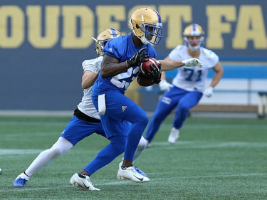 Anthony Gaither (right) jumps in front of Weston Dressler for an interception during Winnipeg Blue Bombers training camp at Investors Group Field in Winnipeg on Mon., May 28, 2018. Kevin King/Winnipeg Sun/Postmedia Network