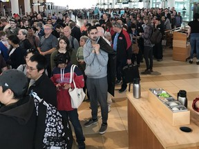 """The security line-up at the Winnipeg Richardson International Airport after passengers and employees were evacuated early Sunday morning due to what airport officials were calling a """"possible security incident""""."""