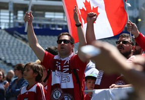 Members of support club Red River Rising cheer during the unveiling of Valour FC, Winnipeg's professional soccer team to begin play in spring 2019, at Investors Group Field in Winnipeg on Wed., June 6, 2018. Kevin King/Winnipeg Sun/Postmedia Network