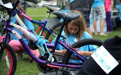 Sadie Van Winkle, 9, decorates her bike after completing the Ride Don't Hide event in support of mental health at Vimy Ridge Park in Winnipeg on Sun., June 24, 2018. Kevin King/Winnipeg Sun/Postmedia Network