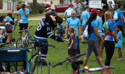 Winnipeg Jets mascot Mick E. Moose slaps hands at the Ride Don't Hide event in support of mental health at Vimy Ridge Park in Winnipeg on Sun., June 24, 2018. Kevin King/Winnipeg Sun/Postmedia Network