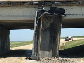 Northbound traffic was reduced to just one lane Friday, on a bridge over the Red River Floodway near Winnipeg, after an over-height vehicle collided with the structure.