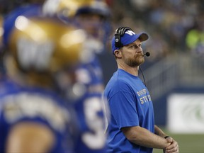 Winnipeg Blue Bombers head coach Mike O'Shea looks up at the scoreboard as they play the Ottawa Redblacks during the second half of CFL action in Winnipeg Friday, August 17, 2018. THE CANADIAN PRESS/John Woods