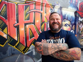 Rich Handford, who is organizing the second annual Winnipeg Tattoo Convention at Red River Exhibition Park this weekend, poses outside his shop, Kapala Tattoo on St. Anne's Road in Winnipeg, on Wed., Aug. 22, 2018. Kevin King/Winnipeg Sun/Postmedia Network