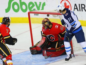 Calgary Flames Mike Smith gives up a goal to C.J. Suess of the Winnipeg Jets during NHL pre-season hockey at the Scotiabank Saddledome in Calgary on Monday, September 24, 2018. Al Charest/Postmedia