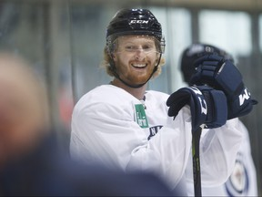 Winnipeg Jets' Kyle Connor (81) smiles during a skating time trial during the Jets NHL training camp.