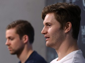Jacob Trouba (right) answers a question while Josh Morrissey waits during the Winnipeg Jets final media availability at Bell MTS Place in Winnipeg on May 22, 2018. (KEVIN KING/Winnipeg Sun)