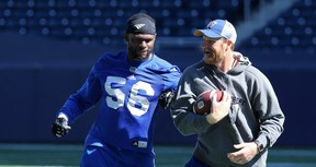 Gerald Rivers (left) playfully tries to slap the ball away from head coach Mike O'Shea during Winnipeg Blue Bombers practice on Wed,. Sept. 5, 2018. Kevin King/Winnipeg Sun/Postmedia Network