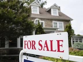 FILE- In this June 8, 2018, file photo a for sale sign stands in front of a house, in Jenkintown, Pa. On Thursday, Sept. 20, Freddie Mac reports on the week's average U.S. mortgage rates.