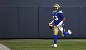 Winnipeg Blue Bombers RB Andrew Harris runs toward the stands after his touchdown reception during CFL action against the Montreal Alouettes in Winnipeg on Fri., Sept. 21, 2018. Kevin King/Winnipeg Sun/Postmedia Network