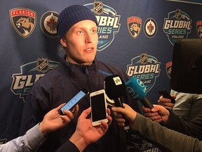 Winnipeg Jets forward Patrik Laine meets the media at a press conference in Helsinki, Finland, on Sunday.