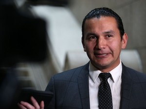 Wab Kinew, leader of the provincial New Democratic Party, speaks with reporters at the Manitoba Legislative Building on Mon., Oct. 29, 2018, about documents revealing cuts and costs associated with the closing of several emergency rooms in Winnipeg. Kevin King/Winnipeg Sun/Postmedia Network