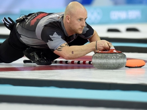 (FILES) In this file photo taken on February 21, 2014 Canada's Ryan Fry throws the stone during the Men's Curling Gold Medal Game between Canada and Great Britain at the Ice Cube Curling Center in Sochi during the Sochi Winter Olympics on February 21, 2014. - Olympic gold medallist Ryan Fry was among a group of four curlers thrown out of a tournament in Canada for