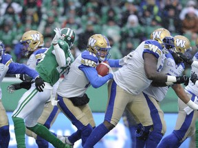 Winnipeg Blue Bombers quarterback Matt Nichols looks for an opening against the Saskatchewan Roughriders during first half CFL West Division semifinal action in Regina on Sunday.