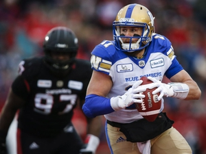 Winnipeg Blue Bombers quarterback Chris Streveler, runs the ball during first half CFL West final football action against the Calgary Stampeders, in Calgary, Sunday, Nov. 18, 2018. THE CANADIAN PRESS/Jeff McIntosh
