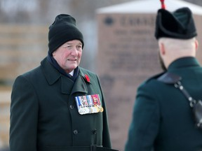 Major-General (retired) Dennis Tabbernor of the Royal Winnipeg Rifles Regimental Senate (left) at the unveiling ceremony of Legacy Stones to mark the regiment's 135th year on Saturday.